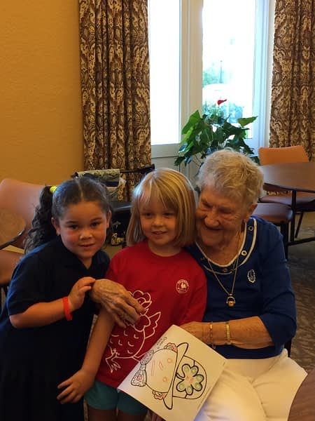 Residents hugging children that came to visit