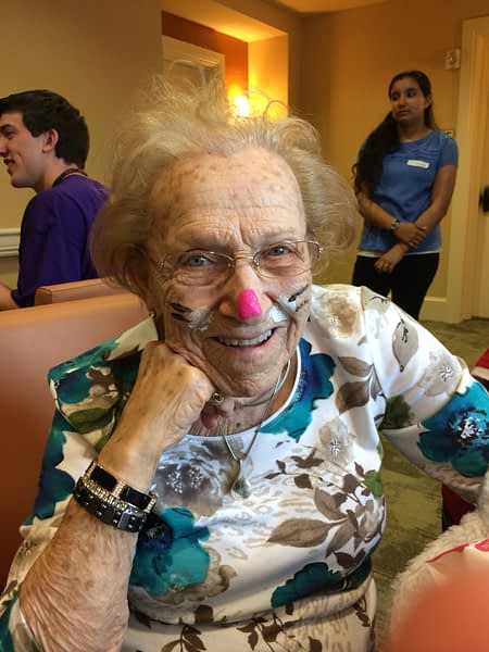 Female resident with face painted like a cat