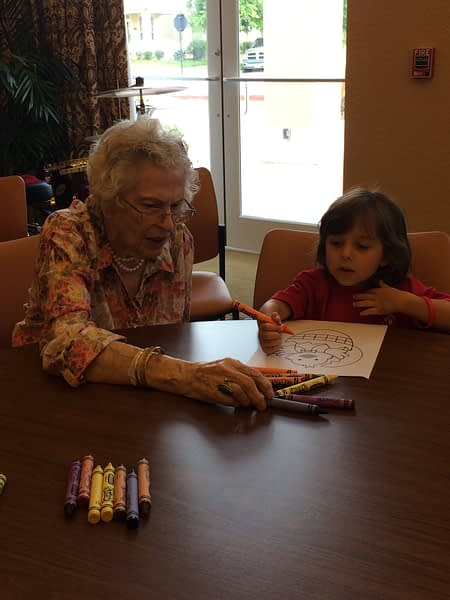 Resident helping child color