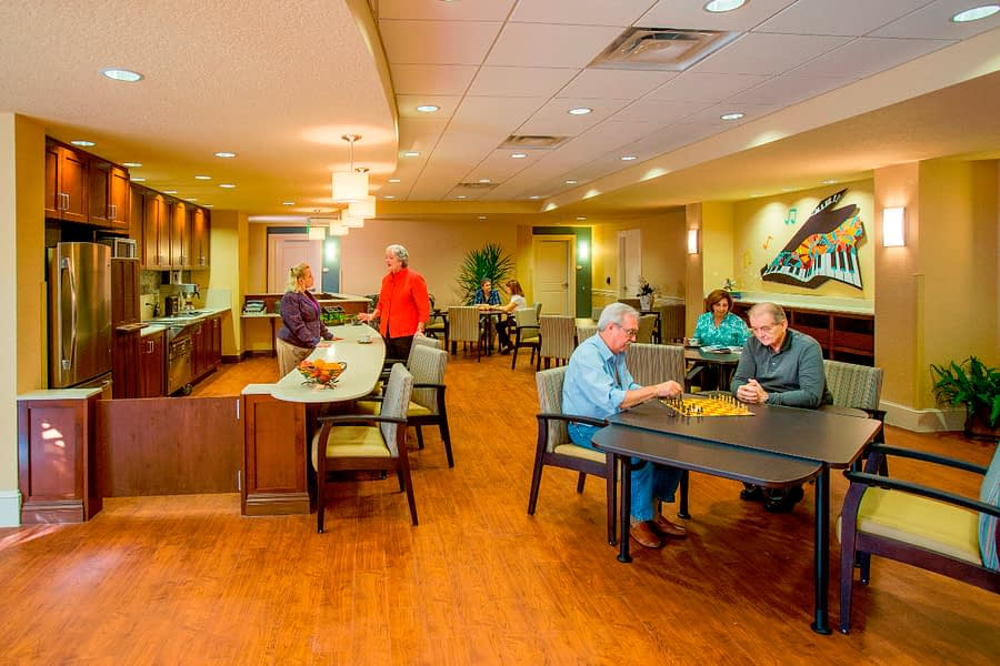 Residents playing chess in the kitchen area