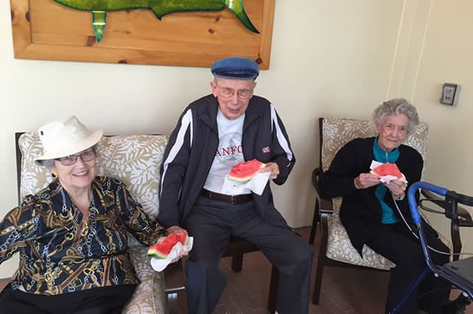 Resident holding a slice of watermelon